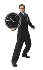 Photo of a man holding a clock.